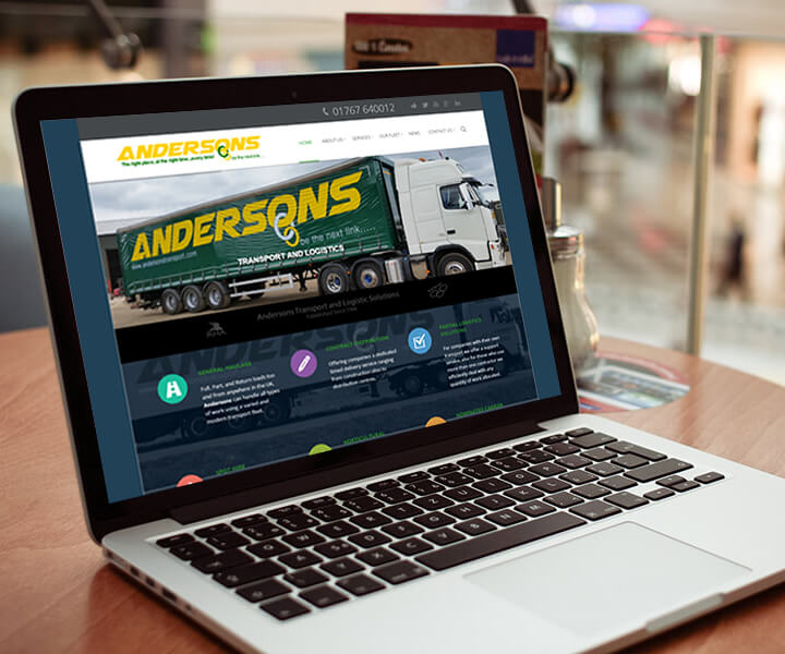 laptop displaying Andersons Transport websites homepage, including a picture of a lorry
